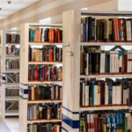 Rows of book shelves in libraries